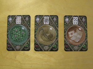 The Clover, Scythe, and Letter cards from the Enchanted Lenormand Oracle.