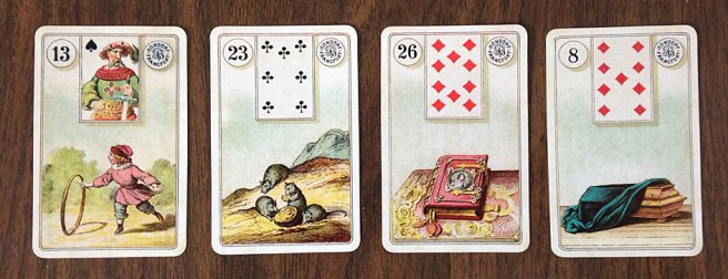 Four Lenormand cards: Child, Mouse, Book, Coffin