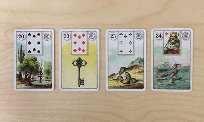 Garden, Key, Mice, and Fish Lenormand cards