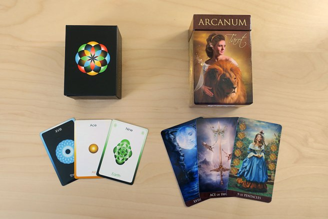 The Orbifold and Arcanum Tarots, with sample cards.