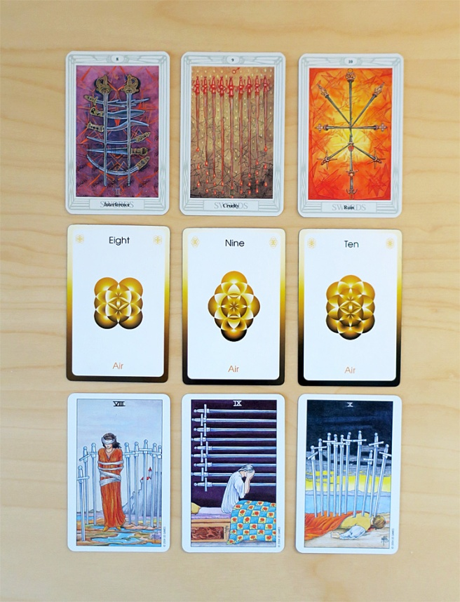 The Eight, Nine, and Ten of Swords from the Thoth and Waite-Smith decks, with the Eight, Nine, and Ten of Air from the Orbifold Tarot between them.